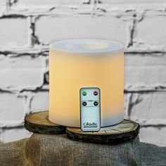 "6"" Oversized Outdoor LED Flameless Candle + Remote Control by Candle Impressions. Love these giant outdoor candles!"