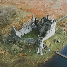 A birds eye view of Kilchurn Castle, Scotland. Built in the it served as a base for the Campbell's of Glenorchy for 150 years. After the first Jacobite Rising of Kilchurn was converted into a garrison stronghold and eventually abandoned by the Abandoned Castles, Abandoned Mansions, Abandoned Places, Chateau Medieval, Medieval Castle, Scotland Castles, Scottish Castles, Beautiful Castles, Beautiful Places