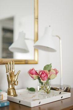 Hang jewelry on a brass sculpture for a pretty (and tidy) display.