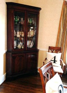 Found on EstateSales.NET: Mahogany Federal style corner cabinet