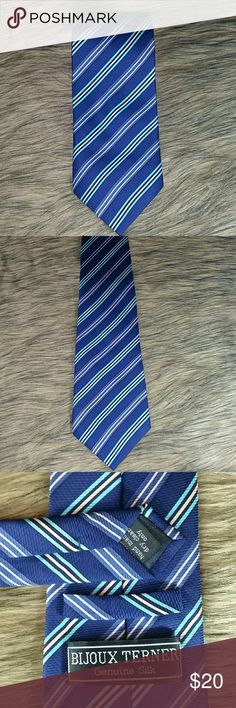 Stunning Bijoux Terner Silk Tie This stunning 100% silk blue tie has light blue, yellow and white pin stripes. Hand sewn. Excellent condition. No trades. Thank you for viewing. Accessories Ties