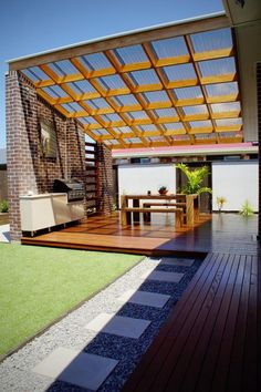 This is another beautiful outdoor kitchen plan. The idea is so amazing that you can cook in a pleasurable way while having comfort and pleasure in your cooking. A covered pergola is simply boosting the grace of the plan while also meant to keep your kitchen, and dining items dry and safe in your outdoor.