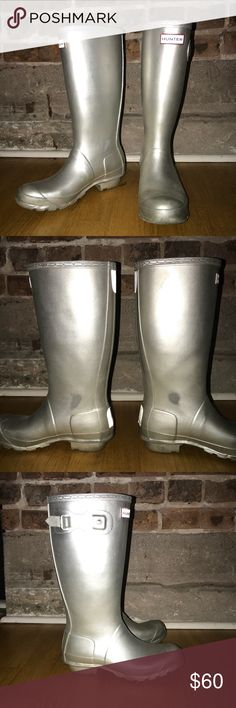 Hunter Limited Edition Silver Rain Boot Silver Hunter rain boots with buckles, logos and soles in great condition! Main sign of wear can be seen on the inner boot shaft where my ankles would meet while walking. Not noticeable while wearing since they don't face outward. EU 37, US 7. Hunter Shoes Winter & Rain Boots