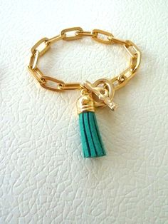 Gold chain and suede tassels bracelets by SofiMoukidouJewels, $15.00..Perfect for stacking:)