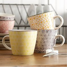Love the pattern and style of these mugs - would use them for all kinds of things (not least of which would be to curl up with a hot cup of coffee and a great book!).
