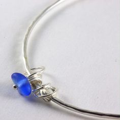 Beautiful seaglass silver charm bangle, just listed in my shop. Love them just worn on their own or in a bunch!