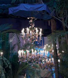 MARIA FELIX, CONTINENTAL GILT-METAL AND COLORED GLASS THIRTY-LIGHT CHANDELIER  20TH CENTURY