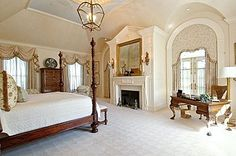 Found this picture of a master bedroom in a home currently for sale.  Love the fireplace and French doors next to each other and the tray ceiling.