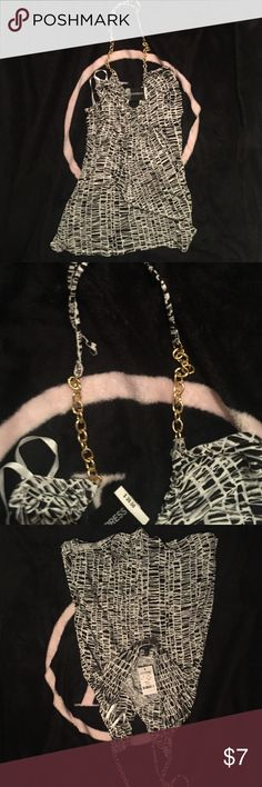 NWT express chain halter small Picture does not do this justice. Super cute halter with chain neck tie, size small, brand new ************Please ask any questions prior to purchasing. Desperately need to downsize, I will be listing lots of items for $5 and will combine shipping on all purchases so please check my other listings!  Thank you for looking! Express Tops Tank Tops