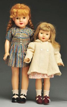 """20"""" and 17"""" composition dolls from the """"American Children"""" series, both featuring human hair wigs, United States, 1936-39, designed by Dewees Cochran for Effanbee Doll Company."""