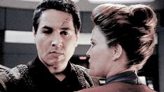 """Janeway totally wants him.>>> and he totally wants her. He's talking about work but his eyes say """"I want you now"""""""