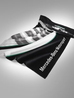 Part number:     B67995143  Motorsport beach towel, black. 100% cotton terry velour, Oeko-Tex Standard 100.  Printed with Formula 1 race motif. Machine washable at up to 40°C. Size: 80 x 160 cm