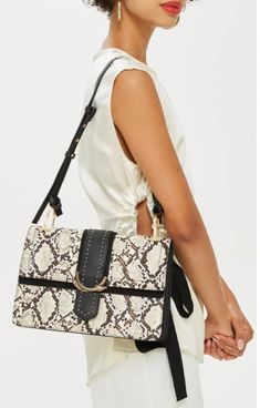 797c76786ada A faux snakeskin front and solid back bring chic sophistication to this  must-have shoulder