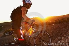 On the bike in sunset by Vladmax, via Dreamstime