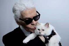 """At the end of this clip promoting the second coming of Karl by Karl Lagerfeld on Net-a-Porter, the designer plants a wet one on Choupette's cheek, complete with exaggerated smooching sound. Also worth noting: The """"famous beauty"""" finally speaks. She says """"meow,"""" and purrs a bunch. Cats! CATS!"""