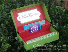 A clever gift box tutorial. The box has a place for a gift card and chocolate/. Designed by Brenda Quintana at http://qbeesquest.blogspot.com/2012/11/pop-up-gift-card-box-tutorial.html
