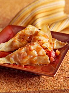 Traditionally, you would make empanadas wrapped in pastry dough, but these wonton-wrapped apple treats crisp up beautifully for a fraction of the calories. #falldesserts #healthydessert #applerecipes #healthyapplerecipes #bhg Healthy Apple Desserts, Good Healthy Recipes, Fall Desserts, Healthy Baking, Delicious Desserts, Apple Cranberry Crisp, Apple Streusel, Apple Bread, Apple Crisp Recipes
