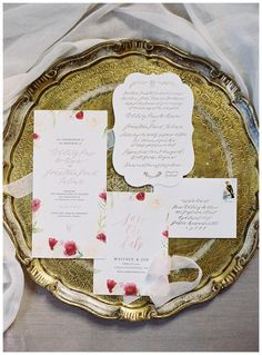 Autumn wedding invitation suite with elegant script and floral details by Rock Paper Scissors. Image by Eric Kelley.