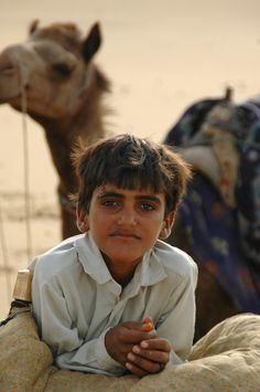Camel boy, Thar Desert - Also known as the Great Indian  Desert, the Thar desert is a vast, arid region in the northwestern part of the Indian subcontinent. It forms a natural boundary running along the border between India and Pakistan.