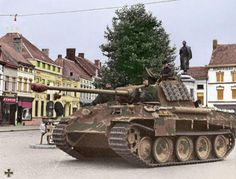 A German Panther tank standing guard at a town square...