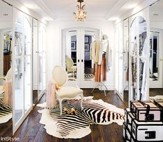 Walk-in closet with Victorian chair and striped cowhide rug