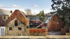 Built in 2014, the unique home sits behind the facade of an old Victorian stable…