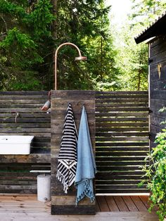 my scandinavian home: A Charming and Relaxed Swedish Summer Cabin By The Sea Outdoor Pool Shower, Jacuzzi Outdoor, Summer Cabins, Scandinavian Cottage, Popular Holiday Destinations, Pool Landscape Design, Bath Bomb Sets, Sheepskin Throw, Outdoor Bathrooms