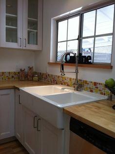 butcherblock countertops, glass tile backsplash