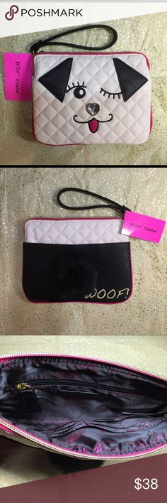 """Betsey Johnson Winky Puppy Large wristlet This cute large wristlet has dimensional face features with a rhinestone nose, also has a fluffy tail on the back plus a compartment with magnetic closure for extra storage space. Interior features Betsey Johnson signature Floral pattern, 1 pocket plus 6 credit card slots. A Heart symbol next to the zipper. Measures 9""""x 7"""". Simply adorable! Betsey Johnson Bags Clutches & Wristlets"""