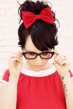 Red bow + red dress + Buddy Holly glasses= one great outfit! Retro and funky and too cute.