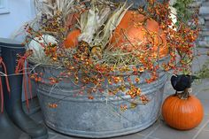 porch display - Autumn harvest - lined with hay/straw - placed in metal bucket