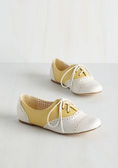Skipping Through the City Flat in Lemon. Today, youre going to take on your city like a tourist would, and you skip down your street in these yellow lace-up flats from Bait Footwear! #yellow #modcloth