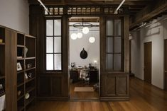 Curiosity Shop: A Multipurpose Room in a NYC Loft : Remodelista.  Spotted: Schoolhouse Orb Lamp and our Llama throw