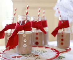 Chocolate Milk Snowmen...Inspired by the simple styling of a snowman, these charming glass jars add extra fun to holiday festivities. Filled with chocolate milk, they're a refreshing addition to a cookie exchange party.