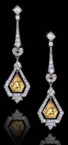 A PAIR OF ART DECO PLATINUM, CITRINE AND DIAMOND EARRINGS, CIRCA 1930. #ArtDeco #earrings