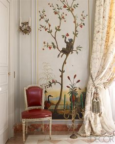 An 18th-century painted chinoiserie panel and gilded-bronze candelabra in the dining room.