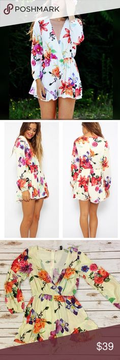 """Long Sleeve V Neck Floral Romper Take the floral trend to the next level with this adorable white romper featuring colorful floral print and plunging V neck. Stretch band at waist and cuffs, fringe trim at hemline/ back zipper. Made of soft cotton/ poly/ viscose blend. Please note: the nature of the fabric, each romper has a unique distribution of the floral print.   Measurements  Small Bust: 33.5""""/ length 28.75"""" Medium Bust: 35""""/ length 29"""" Large Bust: 36.6""""/ length 29.5"""" Bchic Pants…"""