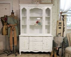 Vintage painted white china cabinet. I can't wait to find one of these and paint it myself! (This one is from Painted Cottages on Etsy, and is $495)