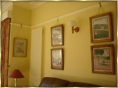 Pictures hung on picture rails