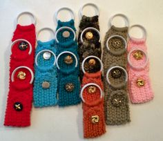 These hand-knit holders are designed to hold a kitchen towel in the white plastic loop. The top then unbuttons and hooks around your door or oven handle for hanging. Made of acrylic yarn, plastic ring Crochet Things, Crochet Gifts, Crochet Doilies, Crochet Ideas, Crochet Projects, Crochet Patterns, Ring Holders, Sew Simple, Crochet Bookmarks