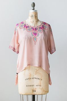 Kittyinva: 1920's pink tissue silk blouse with tassels at sides. From Adored Vintage.