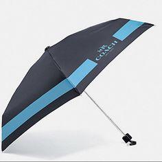 "NWT COACH HC Lock Up Mini Umbrella ""Midnight"" blue/gray  color nylon with ""Lt. Blue"" color logo design. Silver tone hardware.  Attached wrist strap. The perfect size for a handbag, tote or briefcase. Coach Accessories Umbrellas"