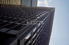 view of a office building against sky. - Low angle shot of a tall commercial building against clear sky.