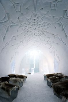Icehotel in Jukksajarvi, Sweden, including Art Suites created by artists from around the world. The temporary hotel is created from snow and ice each winter. This room is the Ice Church. Artists: Mark Szulgit, Julia Orlando Adzuki, Marjolein Vonk & Cindy Berg. The snowflake was the inspiration for the structure designed to be an open, inviting atmosphere for contemplation. // photo by Ben Nilsson