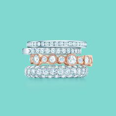 Tiffany & Co. diamond celebration rings, from top: Tiffany Diamond Wedding Band ring with a half circle of diamonds, Tiffany Novo band ring with a half circle of diamonds, Tiffany Cobblestone band ring in 18k rose gold and Etoile three-row band ring. #TiffanyPinterest
