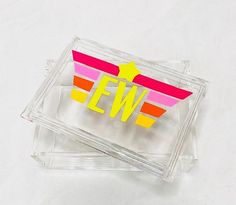 """Our Bold & Bright Collection features Monograms & Motifs that are uniquely bright & graphic prints. Crystal clear acrylic box with two letter initials. Great for jewelry or other small things you want to keep stylishly. 5"""" x 7"""" Acrylic Acrylic Box, Clear Acrylic, Aspen House, Pink Acrylics, Dopp Kit, Small Things, Monograms, Bright Pink, Graphic Prints"""
