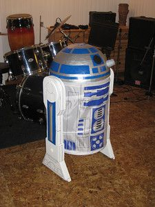 Homemade R2D2 Costume (laundry hamper, paper mache for the head attached with zip ties to a bike helmet for wearing comfort, legs made from styrofoam attached with zip ties)