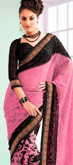 #pink color with #gold embellishment adds sparkle to this #black saree. Like?