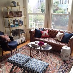Let's all take a moment to  for @stacieflinner and her awesome living room refresh for the new year! With a leather chesterfield sofa and vintage rug, 2016 is looking mighty fine on you!  [Tap the link in our profile to shop these pieces from her living room.] #myoklstyle #regram