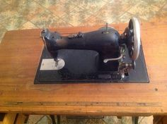 Mystery machine on a treadle; looks similar to a Singer 15.